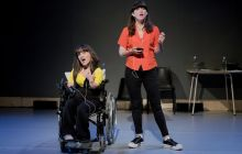 Lisa Hammond (left) and Rachael Spence (right) face the audience, dressed in dark trousers and bright coloured tops. They are contemplating.