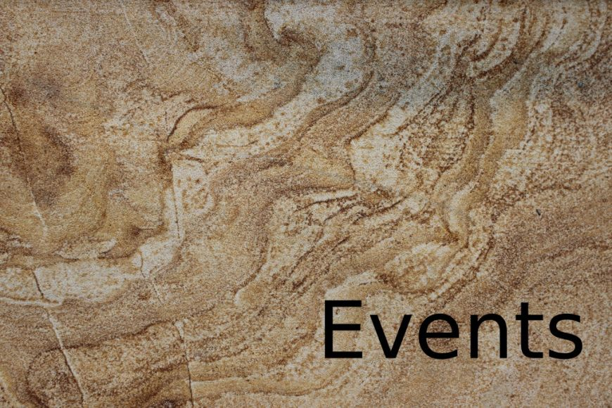 "Holding image: ""Events"" on sandstone wall"