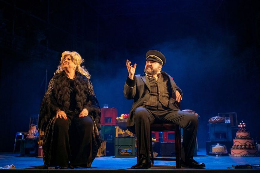 L-R: Sitting, gazing at the world are Elaine C Smith as Mrs Puntila and Steven McNicoll as Matti.