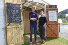 Caelan Mitchell-Bennett and Luch Reis in front of the Greenhouse Fringe venue