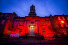 Stockbridge Parish Church lit up red
