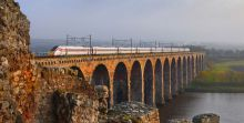 Azuma train crossing a bridge